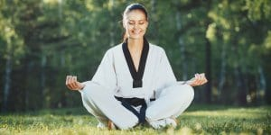 Martial Arts Lessons for Adults in Boscobel WI - Happy Woman Meditated Sitting Background